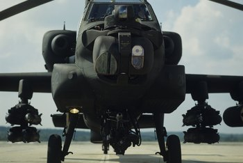 Army aviation school graduates may fly Apache helicopters.