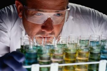 Chemists wear protective clothing to deal with hazardous substances.