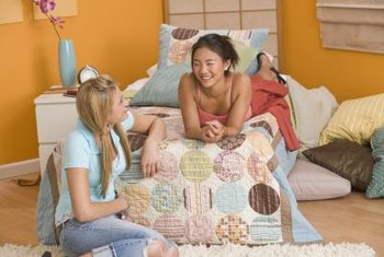 Energetic colors and cozy textiles add designer panache to your teen's small bedroom.
