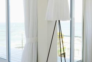 Tension cords replace bulky rods above a ceiling-height window or glass door.