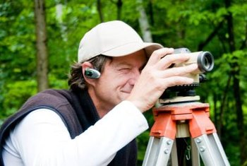 Land surveyors determine property boundaries.