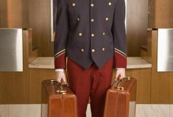 One of a bellhop's main duties is carrying luggage.