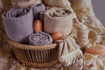 A wicker basket holding towels brings a spa-like vibe to a bathroom.