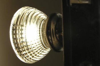 Antique crystal doorknobs catch and refract the light as curtain tiebacks.