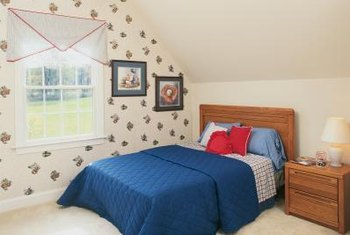 A simple valance offers a budget-friendly window treatment for a boy's bedroom.