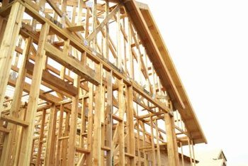 Typically, structural headers are required on exterior and load-bearing walls.