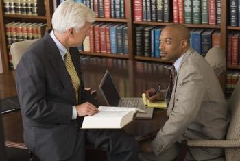 Legal assistants help lawyers research cases and prepare for trial.