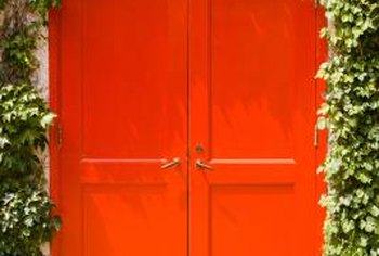 Avoid drips and runs by laying your door flat to paint it.