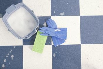 Clean spots or spills on a vinyl floor with soap and water.