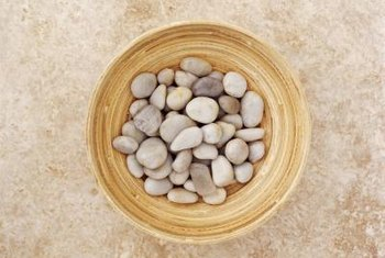 Flat pebbles provide the most usable surface area for applying adhesive.