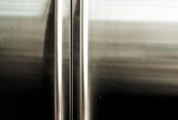 Metal refrigerator handles are usually attached by set screws that require an Allen wrench.