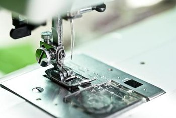 Most home sewing machines will sew suede succesfully when fitted with a leather needle.