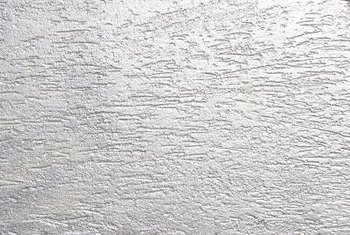 Restoring buckled drywall may involve matching an existing texture.