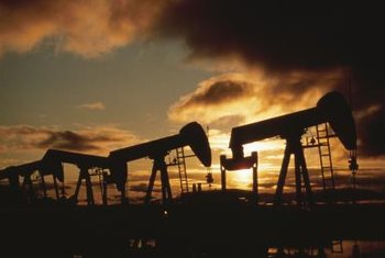 Petroleum engineers work in both offices and oil fields.