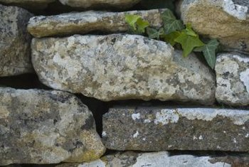 Rock walls are inexpensive and can suit traditional and modern landscape styles.