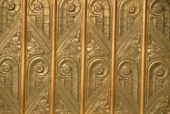 Art deco metalwork may decorate fireplaces from this era.