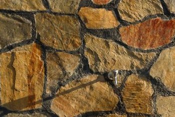 Colored stone slabs add decorative edging to paths and patios.