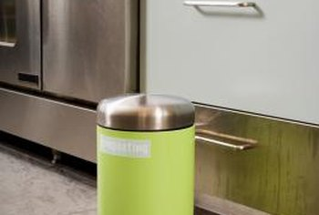 Regular, lidded trash cans can be used as compost bins as long as air can circulate within them.