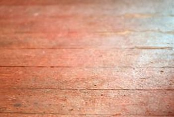 If your wood floor has seen better days, painting it in a solid color can hide the damage.