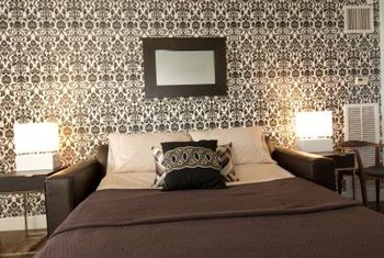 Create a bedroom accent wall with wallpaper.