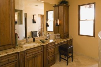 High humidity can stain or warp bathroom cabinet doors.