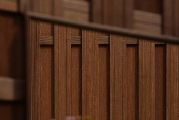 Wooden fence panels can be used to hide concrete block walls from view.