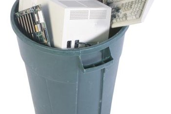 A plastic trash can with tight-fitting lid doubles as a compost bin.