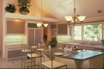 Lights above the cabinets add height to the room and help fill in empty spaces.