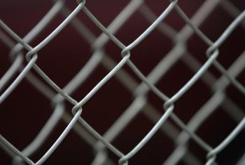 Rejuvenate an old chain-link fence with a coat of paint.