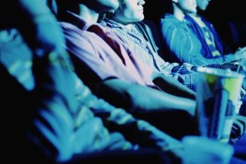 Movie audiences often watch advertisements while waiting for films.