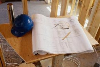 Construction managers follow architectural blueprints in building projects.