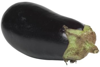 Warm-season vegetables like eggplant, tomatoes and peppers are often grown on black plastic. (See References 1)