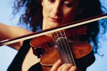 Session violinists play at recording sessions or live performances.