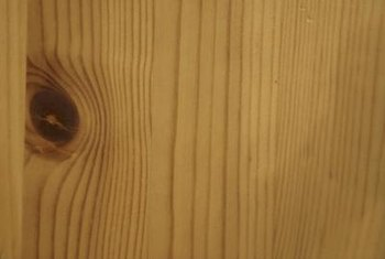 Use wood-graining tools to dress up a flush door.