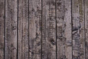 Use pallet slats as vertical or horizontal paneling at interior walls.