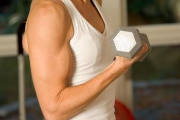 Dumbbell curls help to increase the size of biceps.