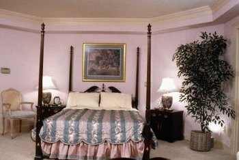 Create an opulent bedroom with a high, four-poster bed.