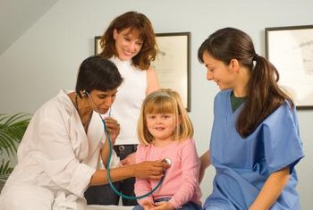 One of a clinic LPN's main roles is to assist the doctor.