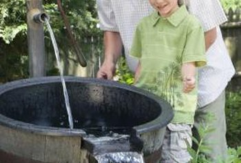 Make a DIY garden fountain with any watertight container and other found objects.