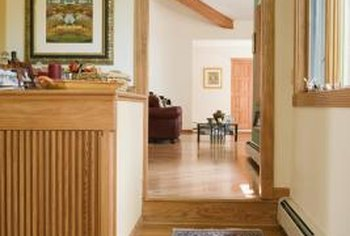 Baseboard heaters warm a room from the floor upward through the space.