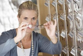 Opticians help customers select stylish eyeglass frames.