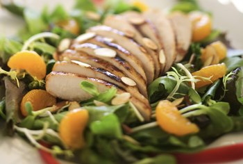 Add grilled chicken to your salad to increase protein without the extra calories.