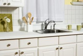 Paint can make your cabinets look new again.