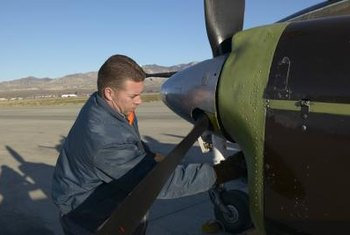 Aircraft mechanics repair engines in airplanes.