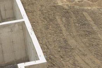 Don't backfill around retaining walls or basement walls until after waterproofing.