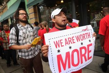 Members of a union of Whole Foods employees protest outside stores.