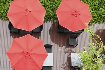 Homemade umbrella holders let you create and control shade in your yard.