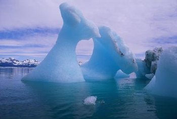 Global warming increases the number of icebergs calving from ice sheets.