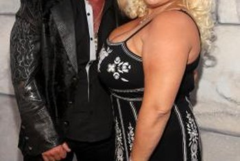 "Television's ""Dog the Bounty Hunter"" and Beth Smith pose for photographers."