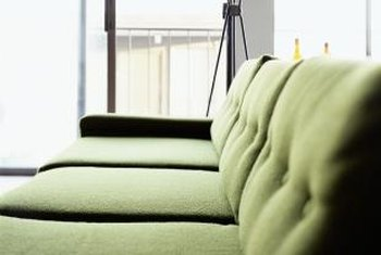 Natural woven wood shades pair well with a lichen green sofa.